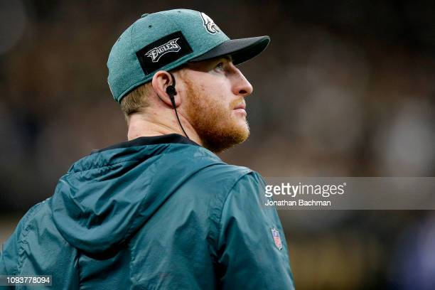 Carson Wentz of the Philadelphia Eagles looks on during the fourth quarter against the New Orleans Saints in the NFC Divisional Playoff Game at...