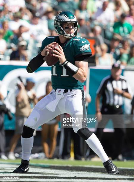 Carson Wentz of the Philadelphia Eagles looks to pass the ball against the New York Giants at Lincoln Financial Field on September 24 2017 in...