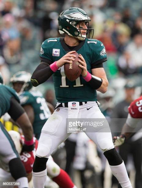 Carson Wentz of the Philadelphia Eagles looks to pass the ball against the Arizona Cardinals at Lincoln Financial Field on October 8 2017 in...