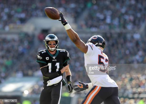 Carson Wentz of the Philadelphia Eagles passes the ball as Khalil Mack of the Chicago Bears bats it down in the first quarter at Lincoln Financial...