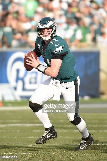 Carson Wentz of the Philadelphia Eagles prepares for the pass during the game against the Los Angeles Rams at the Los Angeles Memorial Coliseum on...