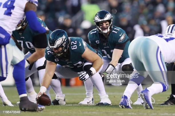 Carson Wentz of the Philadelphia Eagles prepares to take a snap from Jason Kelce during the first half against the Dallas Cowboys in the game at...