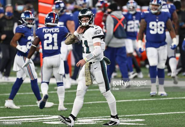 Carson Wentz of the Philadelphia Eagles reacts during the second half against the New York Giants at MetLife Stadium on November 15, 2020 in East...