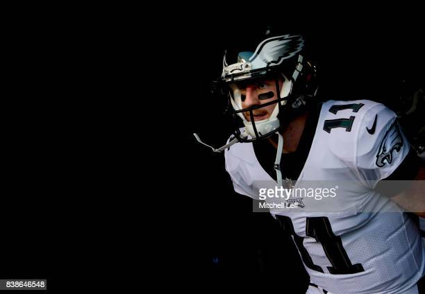 Carson Wentz of the Philadelphia Eagles runs onto the field prior to the preseason game against the Miami Dolphins at Lincoln Financial Field on...