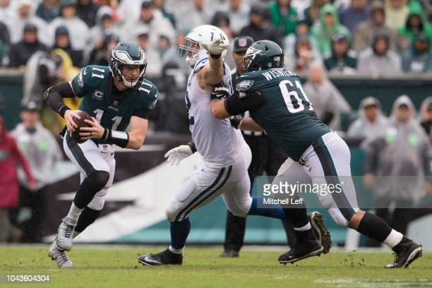 Carson Wentz of the Philadelphia Eagles runs the ball as Margus Hunt is blocked by Stefen Wisniewski of the Philadelphia Eagles at Lincoln Financial...