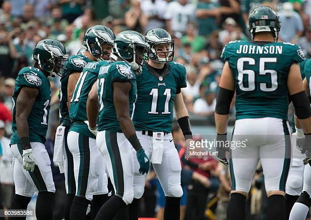 Carson Wentz of the Philadelphia Eagles stands in the huddle with Josh Huff Zach Ertz Jordan Matthews Nelson Agholor and Lane Johnson during the game...