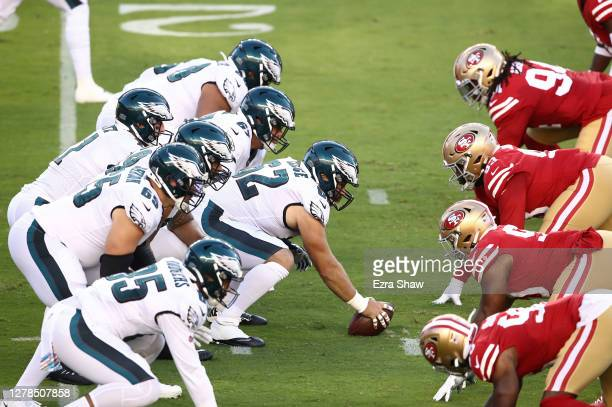 Carson Wentz of the Philadelphia Eagles stands under his center Jason Kelce against the San Francisco 49ers in the game at Levi's Stadium on October...