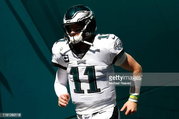 Carson Wentz of the Philadelphia Eagles takes the field prior to the game against the Miami Dolphins at Hard Rock Stadium on December 01, 2019 in...
