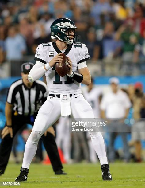 Carson Wentz of the Philadelphia Eagles throws a pass against the Carolina Panthers in the first quarter during their game at Bank of America Stadium...