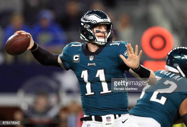 Carson Wentz of the Philadelphia Eagles throws against the Dallas Cowboys in the first half at ATT Stadium on November 19 2017 in Arlington Texas