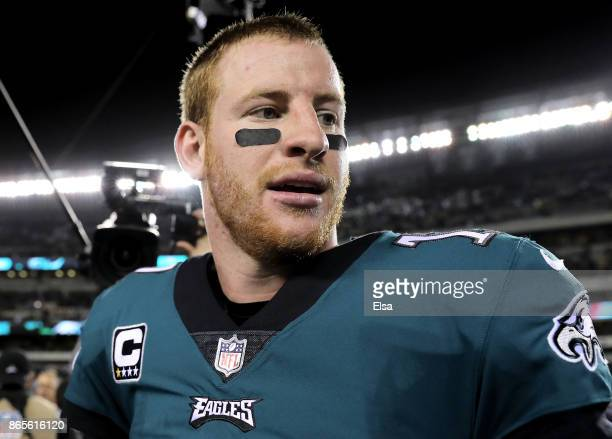 Carson Wentz of the Philadelphia Eagles walks off the field after the 3424 wn over the Washington Redskins on October 23 2017 at Lincoln Financial...
