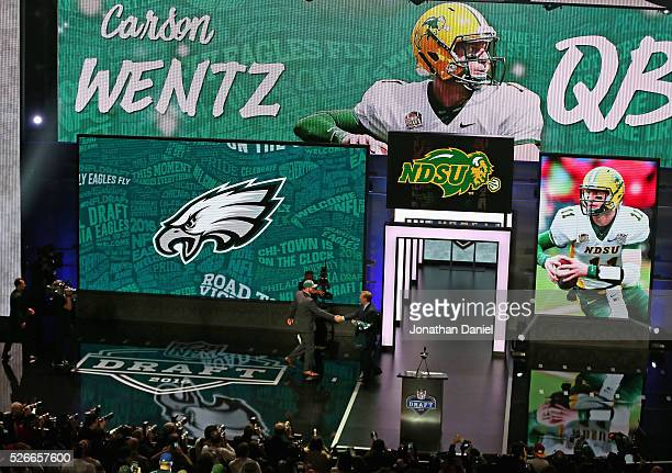 Carson Wentz shakes hands with Roger Goodell during the 2016 NFL Draft at the Auditorium Theater on April 28 2016 in Chicago Illinois