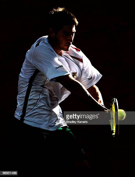 Carsten Ball of Australia plays a backhand during his match against Tatsuma Ito of Japan during the match between Australia and Japan on day three of...