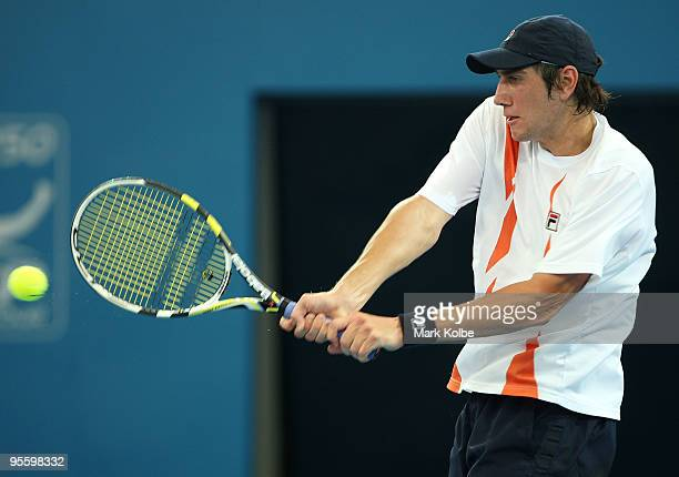 Carsten Ball of Australia plays backhand his second round match against Andy Roddick of the USA during day four of the Brisbane International 2010 at...