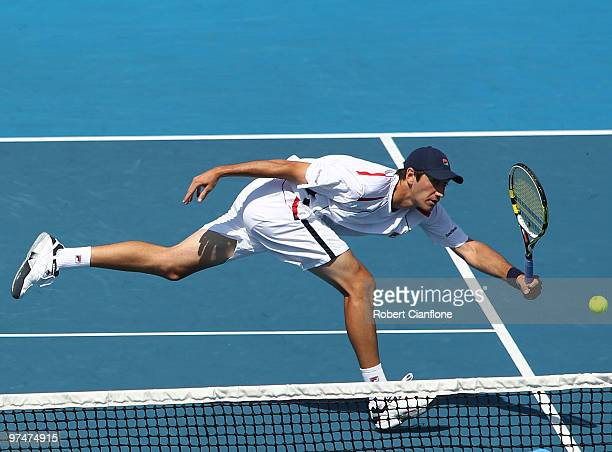 Carsten Ball of Australia returns a shot during the doubles match against TsungHua Yang and ChuHuan Yi of Chinese Taipei during day two of the Davis...