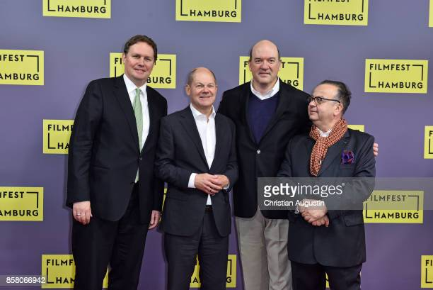 Carsten Brosda Olaf Scholz John Carroll Lynch and Albert Wiederspiel attend the premiere of 'Lucky' during the opening night of Hamburg Film Festival...