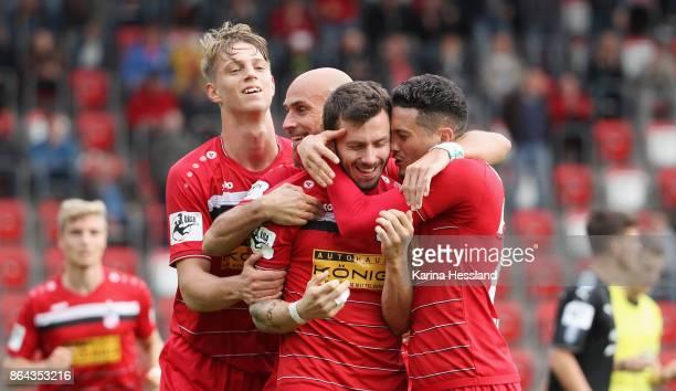Carsten Kammlott of Erfurt celebrates the opening goal with teammates during the 3Liga match between FC RotWeiss Erfurt and Hallescher FC at Arena...