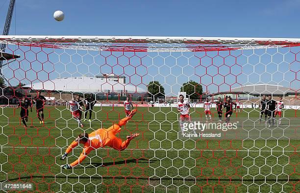 Carsten Kammlott of Erfurt shoots PenaltyKick Goalkeeper Michael Ratajczak of Duisburg saves during the Third League match between FC Rot Weiss...