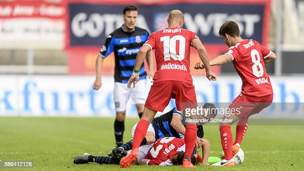 Carsten Kammlott of RW Erfurt and Daniel Brueckner of RW Erfurt challenge Sebastian Schachten of FSV Frankfurt during the Third League match between...