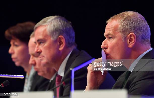 Carsten Kengeter chairman of the Deutsche Boerse AG sits next to board members Hauke Stars Andreas Preuss and Gregor Pottmeyer during the general...