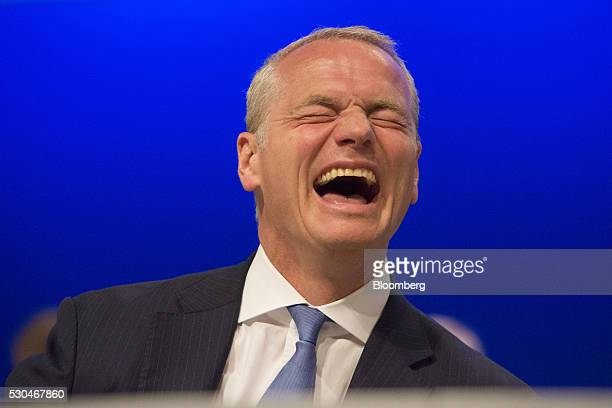 Carsten Kengeter chief executive officer of Deutsche Boerse AG laughs during the German stock exchange's annual general meeting in Frankfurt Germany...