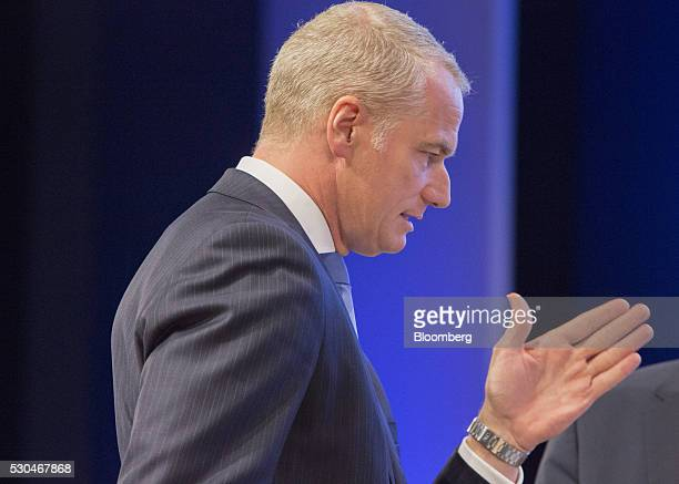 Carsten Kengeter chief executive officer of Deutsche Boerse AG speaks with other attendees during the German stock exchange's annual general meeting...