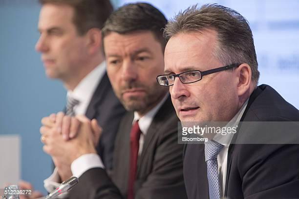Carsten Knobel chief financial officer of Henkel AG right speaks as he sits beside Kasper Rorsted outgoing chief executive officer of Henkel AG...