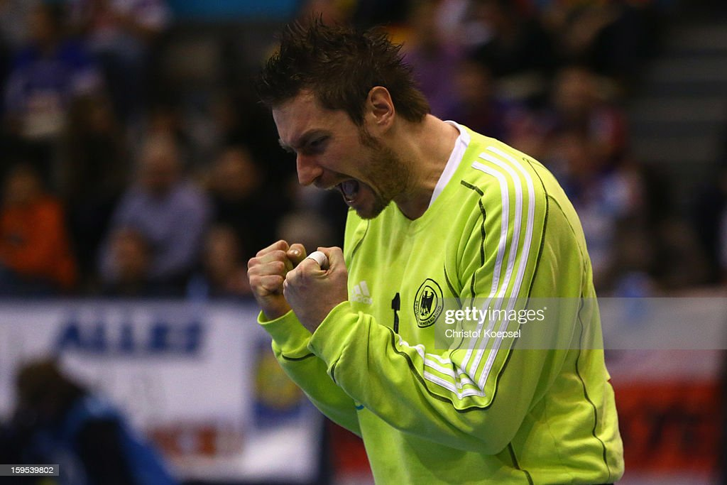 Carsten Lichtlein of Germany celebrates saving a shot during the premilary group A match between Germany and Argentina at Palacio de Deportes de Granollers on January 15, 2013 in Granollers, Spain.