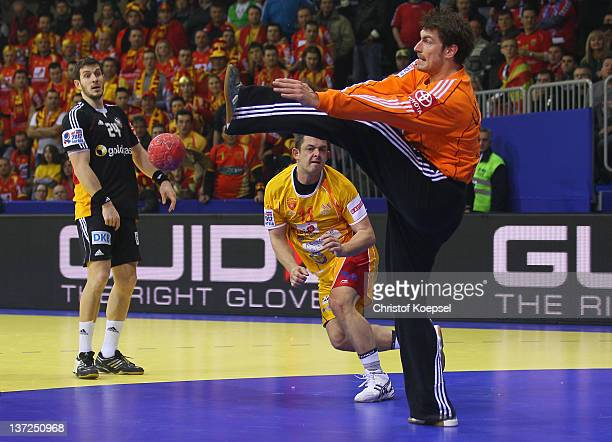 Carsten Lichtlein of Germany saves a ball against Naumche Mojsovski of Macedonia during the Men's European Handball Championship group B match...