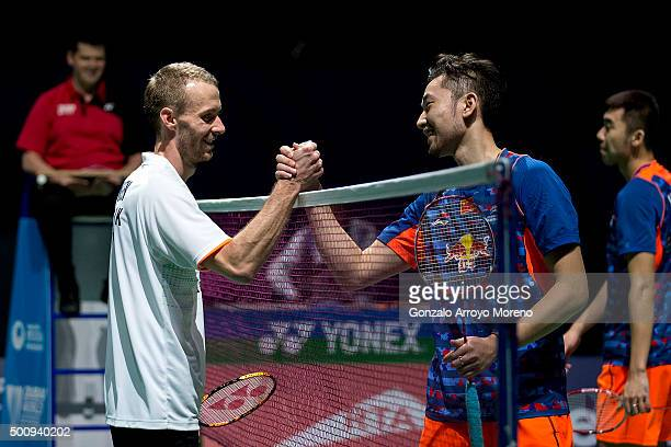 Carsten Mogensen of Denmark clashes hands with Chai Biao of China after winning their Mens Doubles match during day three of the BWF Dubai World...
