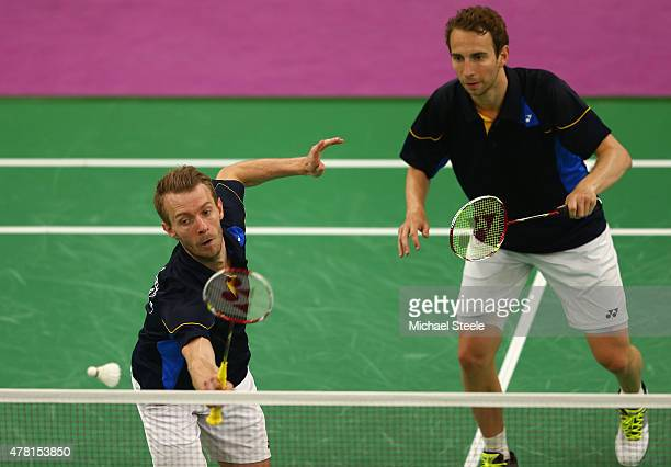 Carsten Mogensen of Denmark serves as Mathias Boe looks on during the Men's Doubles Group A match against Pavel Florian and Ondrej Kopriva of the...