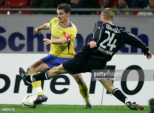 Carsten Rothenbach of Karlsruhe tussels for the ball with Daniel Graf of Braunschweig during the second league match between Eintracht Braunschweig...