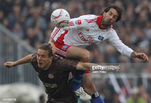 Carsten Rothenbach of St Pauli and Ruud van Nistelrooy of HSV battle for the ball during the Bundesliga match between FC St Pauli and Hamburger SV at...