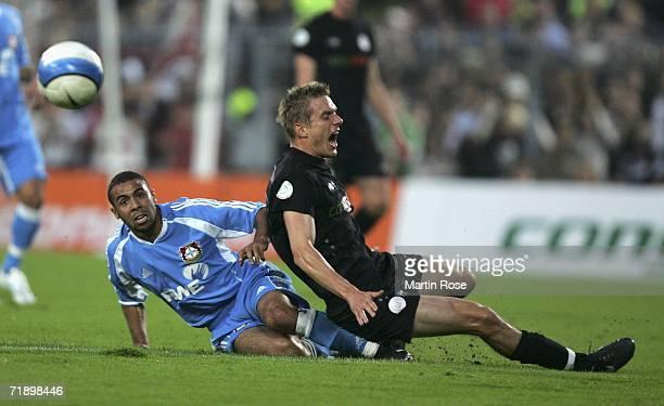Carsten Rothenbach of St Pauli is attacked Rachid Tiberkanine of Leverkusen II during the Third League match between FC St Pauli and Bayer Leverkusen...