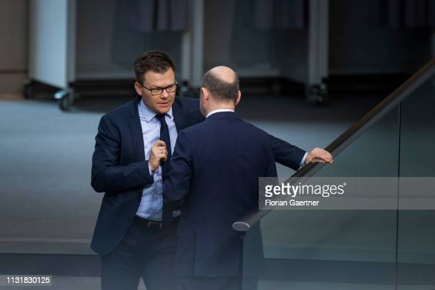 Carsten Schneider German Chief Whip of the SPD parliamentary group talks with German Finance Minister Olaf Scholz during the meeting of the German...
