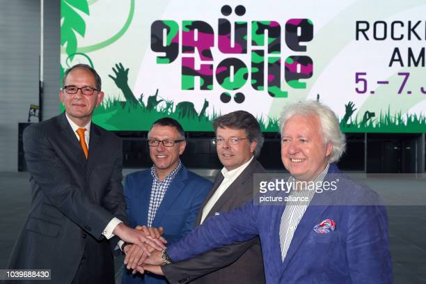 Carsten Schumacher manager of Nuerburgring CapricornGmbH Stuart Galbraith Peter Schwenko and Ossy Hoppe pose in front of the new logo Gruene Hoelle...
