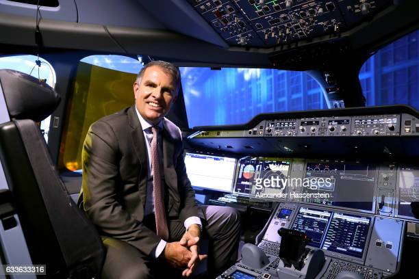 Carsten Spohr Chairman of German airline Lufthansa sits in the pilot's seat in the cockpit of the German airline's first ever Airbus A350900...