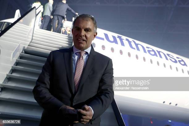 Carsten Spohr Chairman of German airline Lufthansa stands under the company's first Airbus A350900 passenger plane during a rollout event at Munich...