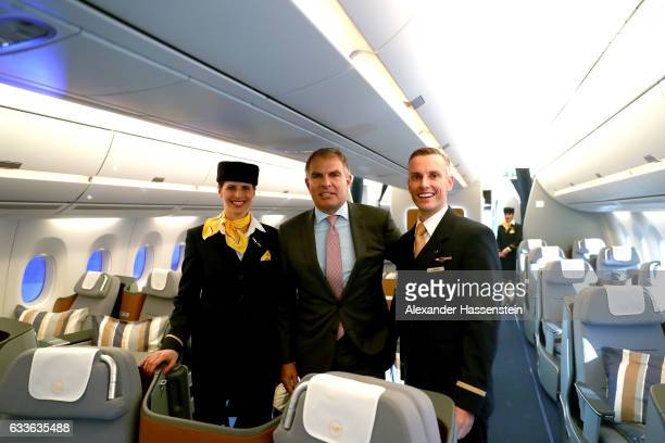 Carsten Spohr Chairman of German airline Lufthansa stands with an airhostess and a steward in the cabine at the passenger deck of the company's first...