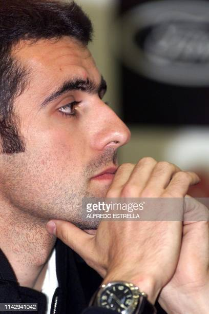 Cart driver Dario Franchitti of Scotland answers questions during a press conference 14 November 2002 in Mexico City Training begins 15 November for...