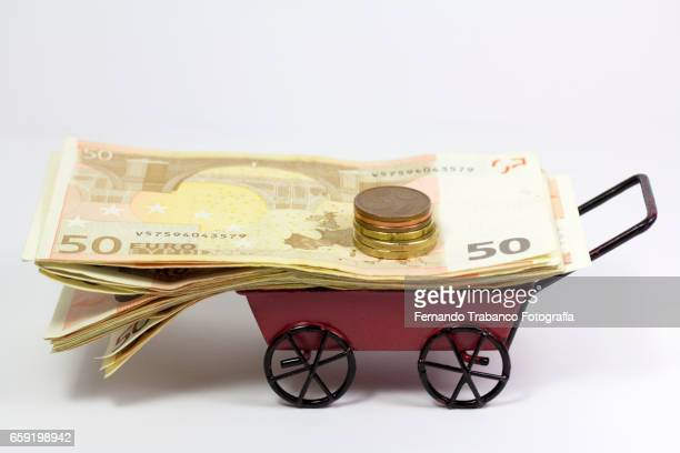 Cart full of money. Bank Mortgage Loan