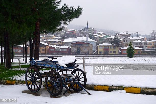 cart layered under snows in bolu - bolu city stock photos and pictures