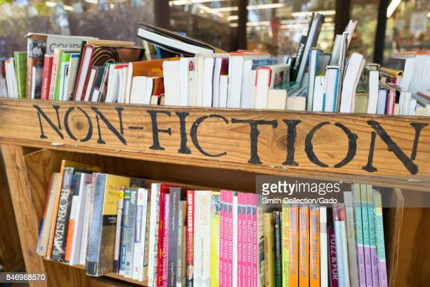 Cart with books outside an independent bookstore in downtown Concord California with handstenciled lettering reading 'Non Fiction' September 8 2017