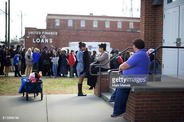 A cart with Hillary 2016 tshirts for sale is unattended while a crowd gathers outside the Cumberland United Methodist Church unable to attend the...