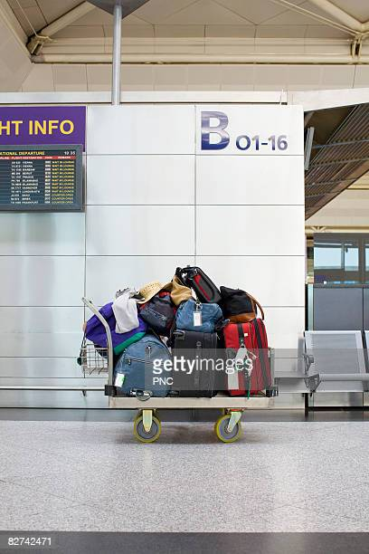 Cart with pile of luggage