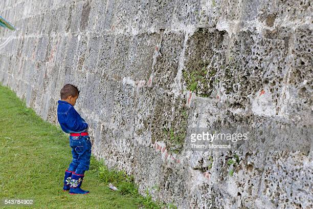 Cartagena Colombia August 23 2015 A boy is peeing on the defensive wall of Cartagena