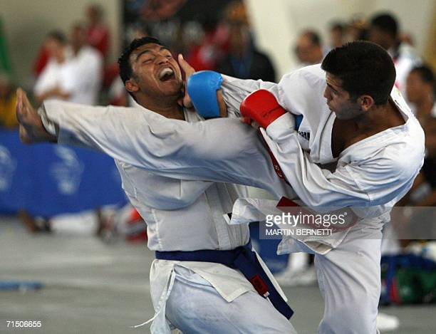 El karateca Midiet Roque de Cuba aplica una patada a su contrincante colombiano Francisco Cifuentes durante la pelea de karate Do Kumite categoria 85...