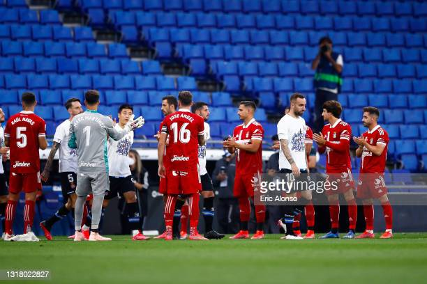 Cartagena players give a guard of honor to Espanyol to congratulate them on promotion of LA Liga Santander during the Liga Smartbank match betwen RCD...