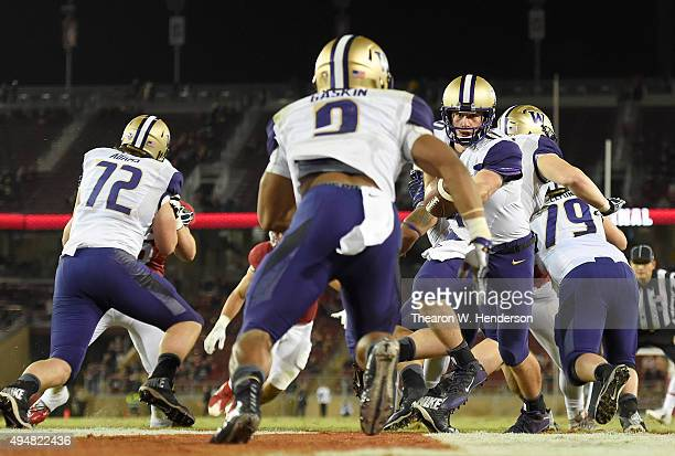 J CartaSamuels of the Washington Huskies turns to hand the ball off to running back Myles Gaskin against the Stanford Cardinal's in the fourth...