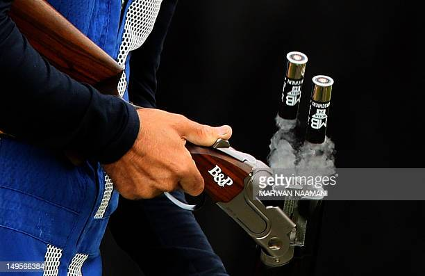 Cartbridges are removed by Ennio Falco of Italy as he competes in the men's skeet shooting qualification of the London 2012 Olympic Games at the...